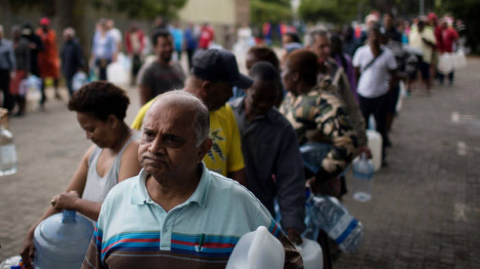 Cape Town water crisis - people stand in long line for water